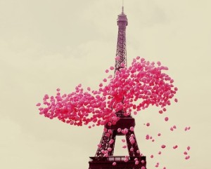 Eiffel tower with pink balloons